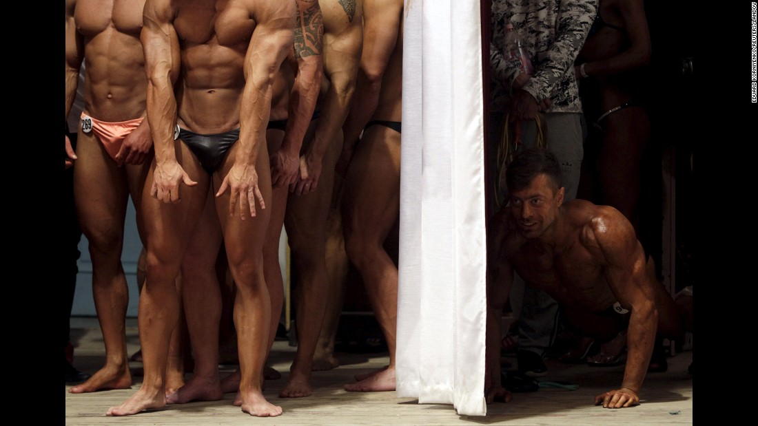 Bodybuilders wait backstage during a competition in Stavropol, Russia, on Saturday, April 4.
