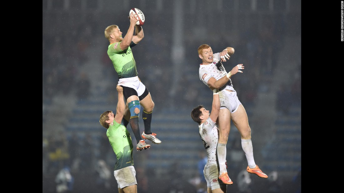 South Africa's Kyle Brown catches the rugby ball while playing England in the final of the Tokyo Sevens on Sunday, April 5. England won the match 21-14.
