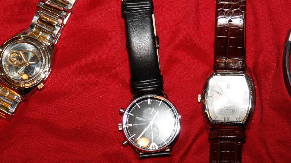 Police recovered multiple watches. They raided the homes of baggage handlers after getting tipped off to a ring of thieves at two terminals.