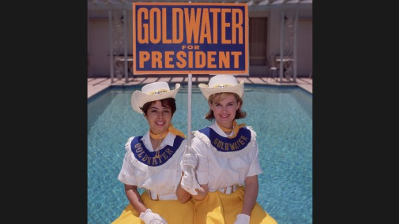 """Two """"Goldwater girls"""" in July 1964 in Sherman Oaks, California, campaign for Barry Goldwater, the Republican candidate for president. Goldwater"""