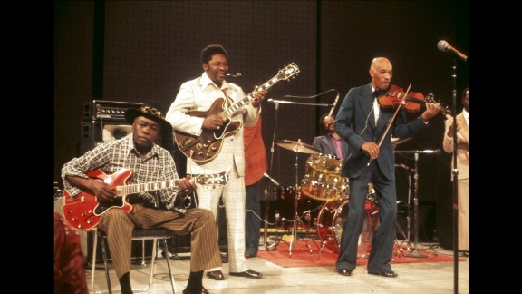 """From left, John Lee Hooker, King and Papa John Creach perform on the television show """"The Midnight Special"""" in 1974."""