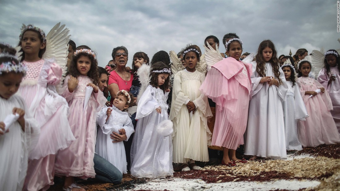 "APRIL 7 - OURO PRETO, BRAZIL: Girls dressed as angels take part in the annual Easter procession during traditional Semana Santa (Holy Week) festivities. Holy Week marks Easter celebrations for Catholics and<a href=""http://www.pewforum.org/2013/07/18/brazils-changing-religious-landscape/"" target=""_blank""> Brazil holds the largest number of followers of the faith.</a>"
