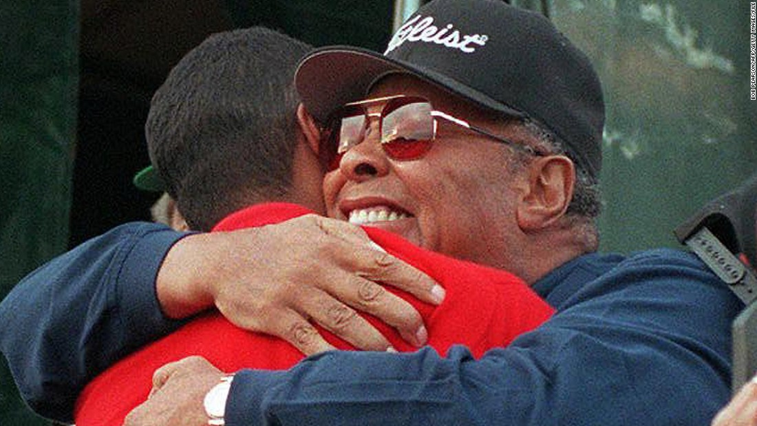 Woods is hugged by his father in 1997 after winning the Masters for the first time. Earl Wood would see his son don the prestigious green jacket on three more occasions before he passed away in 2006, aged 74 -- three weeks after that season's opening major, where Tiger tied for third as he sought to defend his Masters title.