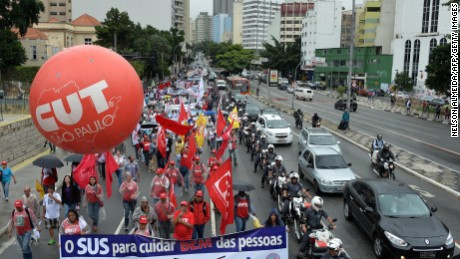 Unionists take part in a demonstration called 'National Day in Defense of the Workers' Rights' in Sao Paulo, Brazil on April 7, 2015. AFP PHOTO / NELSON ALMEIDA (Photo credit should read NELSON ALMEIDA/AFP/Getty Images)