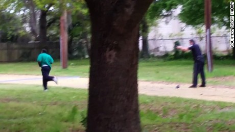 This still, released by the family of Walter Scott, shows police officer Michael Slager shooting Scott in the back as he ran away on April 4, 2015, in North Charleston, South Carolina. Slager was convicted of 2nd-degree murder and sentenced to 20 years in prison.