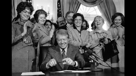 Also in 1978, then-President Jimmy Carter signed legislation extending the original ERA ratification deadline from 1979 to 1982. Among those watching is his wife, Rosalynn, far right. Now 90, Carter says he is devoting the rest of his life to fighting for women