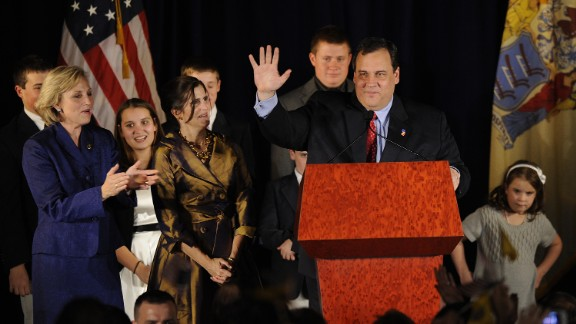 Christie waves to supporters with Lt. Gov.-elect Kim Guadagno, left, on November 3, 2009, in Parsippany, New Jersey. Christie defeated incumbent Democrat Jon Corzine.