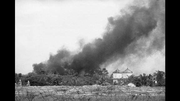 Smoke from a napalm bomb rises over a Trang Bang church.