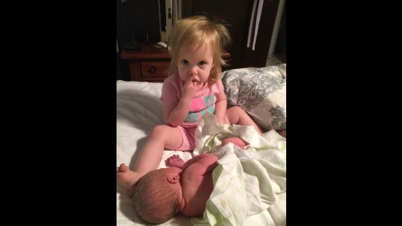 """""""My son had been born at home at 4 a.m. while Julia was sleeping in the front bedroom. My husband brought her in when she woke up and she immediately kissed her baby brother. ... Then she couldn't stop staring in amazement at him."""" -- Jennifer Prescott, Tustin, California"""