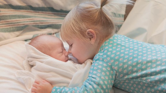 """CNN invited readers last year to share photos of children with their new siblings. Here, Cecelia, 2, meets baby Sullivan. """"Cece is very possessive of her little brother. 'He's mine' or 'my brother' or 'my Sully' are her favorite things to say to strangers when we are out together in public."""" -- Cary Chadwick, Higganum, Connecticut"""