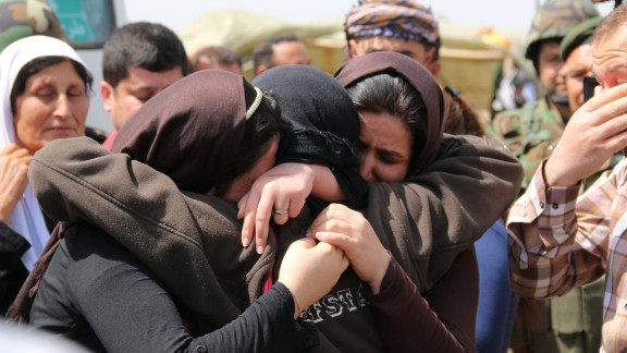 Yazidis embrace after being released by ISIS south of Kirkuk, Iraq, on Wednesday, April 8. ISIS released more than 200 Yazidis, a minority group whose members were killed, captured and displaced when the Islamist terror organization overtook their towns in northern Iraq last summer, officials said.