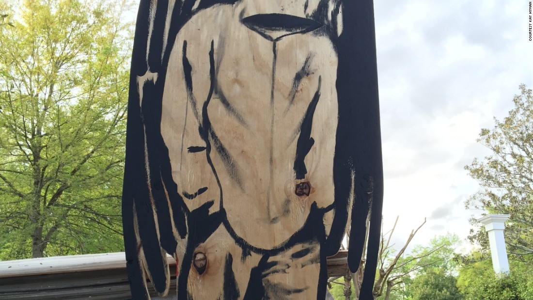 Hyman, who grew up in a rough neighborhood in North Charleston, couldn't sleep after he heard about the shooting. At 3 a.m. on Tuesday, he rifled through his trash, found the perfect piece of wood and created this piece of art.