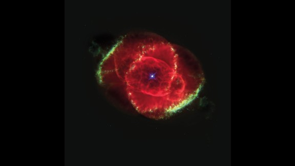 The Cat's Eye Nebula is a bunch of glowing gases kicked out into space by a dying star. This Hubble Space Telescope image shows details of structures including jets of high-speed gas and unusual knots of gas. This color picture is a composite of three images taken at different wavelengths. The nebula is estimated to be 1,000 years old. It's about 3,000 light years from Earth in the constellation Draco.