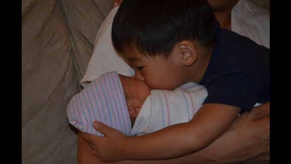 """""""He was so excited to see a baby at home, he kept on trying to hug, kiss and hold him. Of course, then he started to realize that Nathan wasn't here as a visitor, but a new member of our family."""" -- Gina J. Chan, Braintree, Massachusetts"""