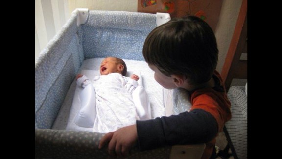 """""""Edison was so excited to meet his baby brother. Every picture we own shows him touching Donovan in some sweet way. Two years later, we lost our dear Edison. We know he continues to watch over Baby D, his brovey."""" -- Jennifer Ruef, Chapel Hill, North Carolina"""