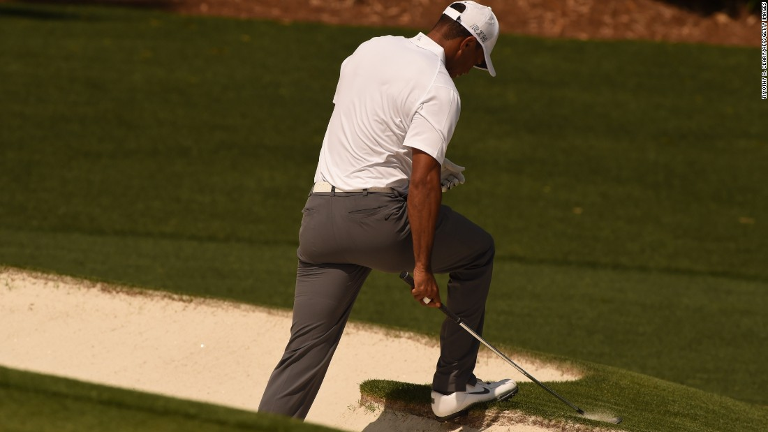 Woods, whose last Masters success was back in 2005, climbs out of a bunker at the fourth hole -- where he dropped another shot. The 39-year-old got back to level par with a birdie at the eighth.