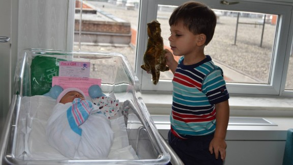 """""""The fact that Jack is showing Lucy his precious dinosaur is proof of the immediate bond between brother and sister."""" -- Etan Horowitz, Atlanta, Georgia"""