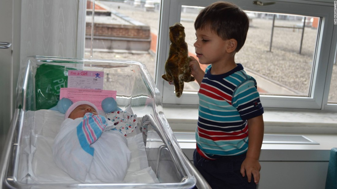 """The fact that Jack is showing Lucy his precious dinosaur is proof of the immediate bond between brother and sister."" -- <a href=""http://ireport.cnn.com/docs/DOC-1232457"">Etan Horowitz</a>, Atlanta, Georgia"