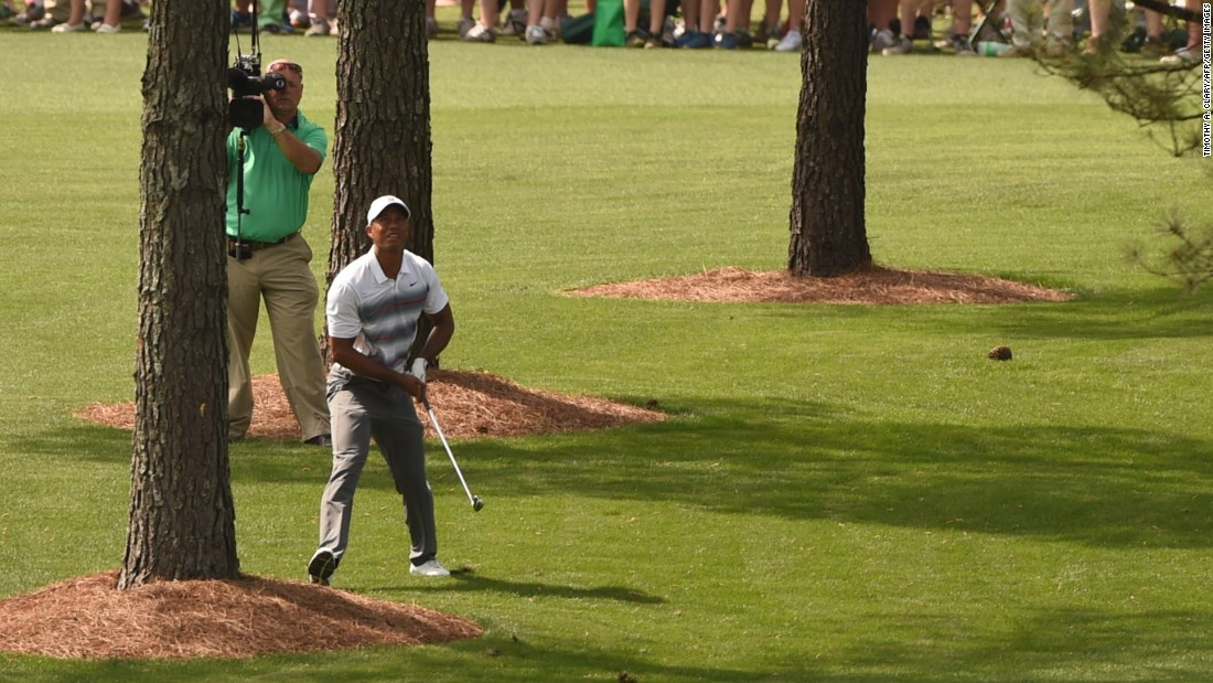 Woods, who won the last of his 14 major titles in 2008, struggled off the tee on the front nine but this superb shot from behind a tree helped him save par on the seventh hole. He continued to scramble and ended the day tied for 41st on 73.