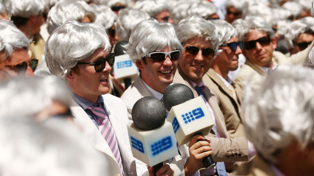Many fans impersonates Richie Benaud by wearing his iconic white hair wig and holding fake microphones in the cricket match between Australia and England on January 4, 2014 in Sydney, Australia.
