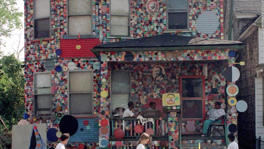 Visitors walk past the Dotty Wotty House in the Heidelburg Project.