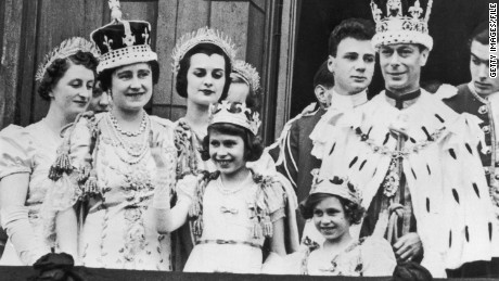 The royal family on the balcony at Buckingham Palace on September 12, 1937 after the coronation of King George VI. King George VI (R) stands with Princess Elizabeth (C) and Princess Margaret.