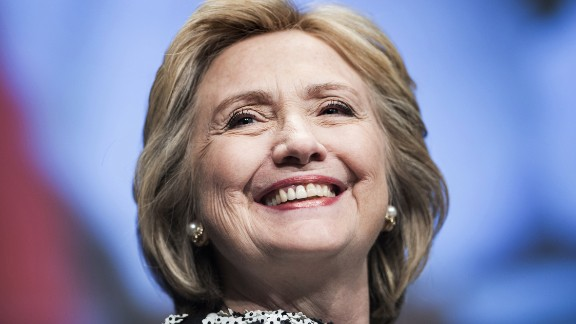 Former Secretary of State Hillary Clinton smiles before speaking at the World Bank May 14, 2014 in Washington, DC. Clinton and World Bank President Jim Yong Kim joined others to speak about women's rights. AFP PHOTO/Brendan SMIALOWSKI        (Photo credit should read BRENDAN SMIALOWSKI/AFP/Getty Images)