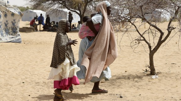 In this picture taken on April 7, 2015, Nigerian refugees walk in a camp named Dar-es-Salam in the Chad lake region.