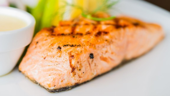 """The MIND diet suggests eating at least one serving of fish a week. In contrast, <a href=""""http://www.uhs.wisc.edu/health-topics/healthy-lifestyle/documents/Mediterranean.pdf"""" target=""""_blank"""" target=""""_blank"""">the Mediterranean diet</a> suggests eating more like 2-3 servings a week. Salmon, considered a """"superfood,"""" gives you a high dose of omega-3 fatty acids which studies show lower the risk of heart disease and fight inflammation. <a href=""""http://researchnews.osu.edu/archive/omega3.htm"""" target=""""_blank"""" target=""""_blank"""">Earlier studies</a> showed it also reduces anxiety."""