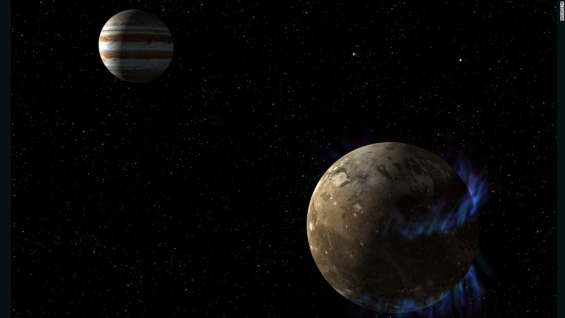 In this artist's concept, the moon Ganymede, right, orbits the giant planet Jupiter. NASA's Hubble Space Telescope observed auroras on the moon generated by Ganymede's magnetic fields. A saline ocean under the moon's icy crust best explains shifting in the auroral belts measured by Hubble.