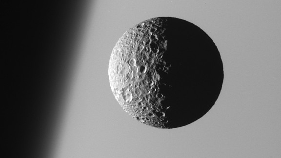 "Mimas, the smallest and closest of Saturn's eight main moons, is heavily cratered and has a low density that suggests it is mostly composed of water ice. The moon's main 88-mile-long crater makes it resemble ""Death Star"" from ""Star Wars Episode IV."""