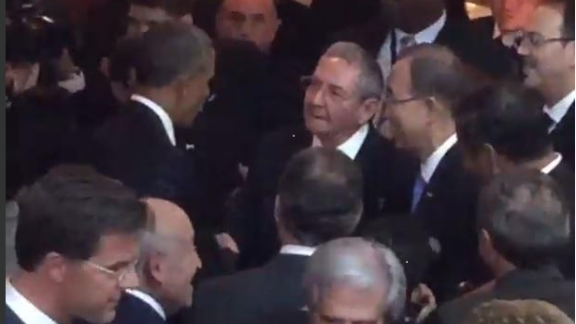President Obama greets and shakes hands with Cuban leader Raul Castro at the Summit of the Americas in Panama City, Panama.