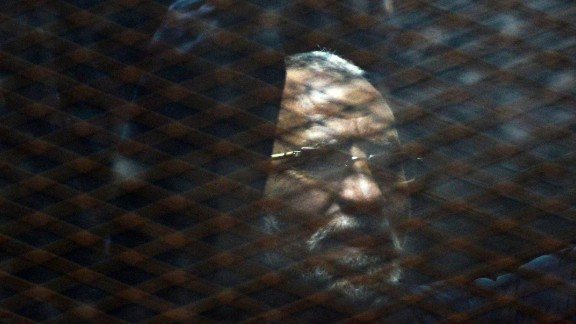 Caption:Egyptian Muslim Brotherhood leader Mohamed Badie stands behind bars during his trial at the non-commissioned police officers institute in the capital Cairo on 28 February, 2015. The court sentenced Badie to life imprisonment over the killing of protesters who stormed the group