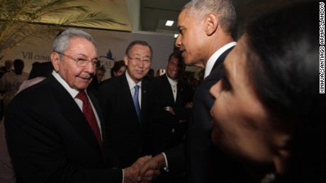 President Barack Obama shakes hands with Cuban leader Raul Castro on Friday in Panama City, Panama.