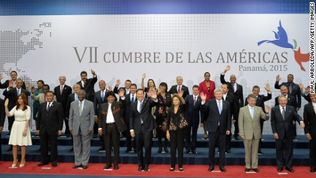 Presidents and Heads of State pose during the family picture of the VII Americas Summit at the Convention Center in Panama City on April 11, 2015. US President Barack Obama and Cuba's Raul Castro heralded a new era of bilateral relations on Saturday as they both addressed a landmark Summit of the Americas ahead of historic one-on-one talks. AFP PHOTO / RAUL ARBOLEDA        (Photo credit should read RAUL ARBOLEDA/AFP/Getty Images)
