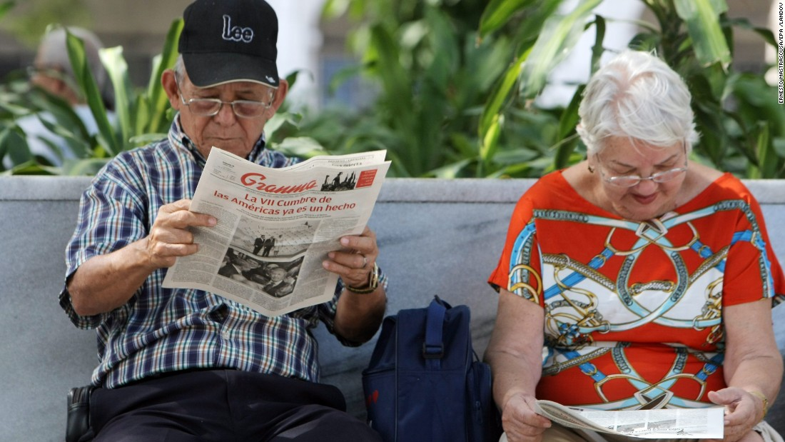 In Havana, a couple read newspaper coverage of the historic meeting at the summit on April 11.