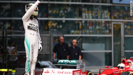 Lewis Hamilton celebrates after taking pole position in Shanghai in dramatic fashion.