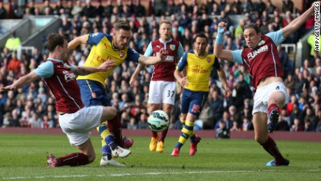 Aaron Ramsey fires Arsenal ahead against Burnley in the English Premier League.