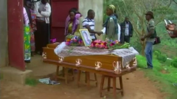 cnni kriel pkg village holds funeral for masscre victim_00022710.jpg
