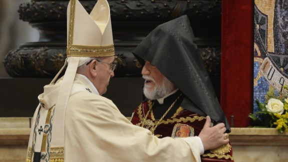 Aram I, head of the Catholicosate of the Great House of Cilicia, speaks with Pope Francis during an Armenian-Rite Mass Sunday at St. Peter's Basilica.
