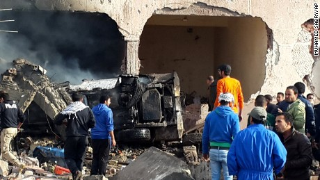 Egyptians gather at the scene following a bombing that struck a main police station in the capital of the northern Sinai province in el-Arish, Egypt, Sunday, April 12, 2015. The explosion comes hours after a roadside bomb killed many soldiers traveling south of el-Arish in an armored vehicle. The region has been hit by an Islamic insurgency by a group that recently pledged allegiance to the Islamic State. (AP Photo/Muhamed Sabry)