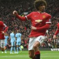 fellaini celebrates manchester derby