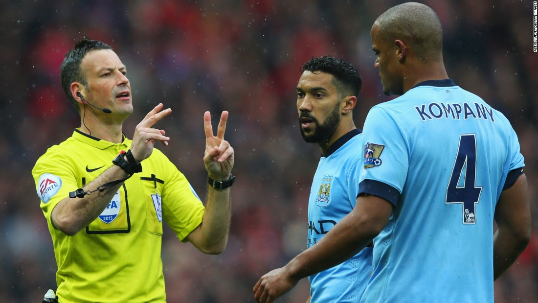 City captain Vincent Kompany (right) was lucky to escape with a yellow card for a late tackle on Daley Blind, but had to come off at halftime due to injury.