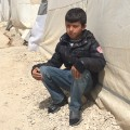 yazidi refugee camp boy tent