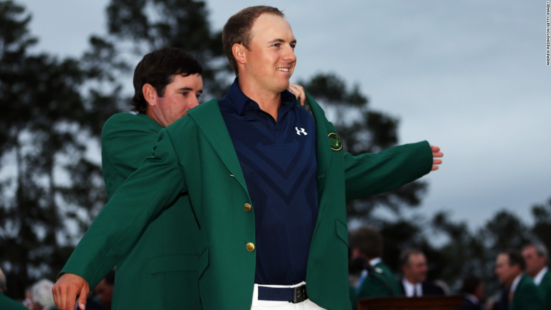 "Defending champion Bubba Watson presents Jordan Spieth with the champion's green jacket after he <a href=""http://www.cnn.com/2015/04/12/golf/masters-jordan-spieth-golf/index.html"">won the 2015 Masters Tournament</a> on April 12 in Augusta, Georgia."