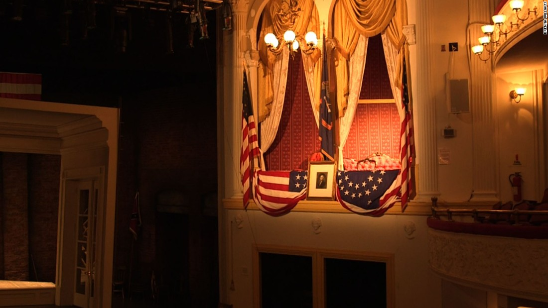 The State Box at Ford's Theatre is pictured in present day. The portrait of George Washington is the same one that hung on the box on the night of the assassination in 1865. There is a nick on the frame where John Wilkes Booth's spur struck it as he jumped from the box to the stage after he shot Lincoln.