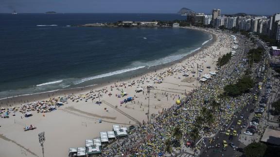 In Rio de Janeiro, Brazilians gathered and marched along Copacabana beach.