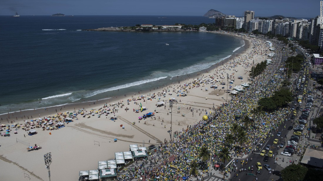 In Rio de Janeiro, Brazilians gathered and marched along Copacabana beach.