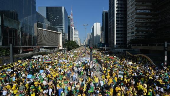 Demonstrators protest along Paulista Avenue.