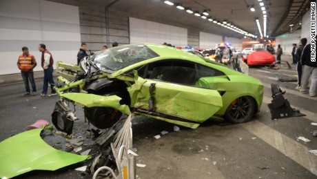 A wrecked Lamborghini lies in the center of a Beijing tunnel after a crash involving a Ferrari in a high-speed road race on April 11.